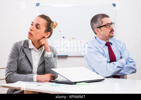 Business colleagues are not talking to each other. - Stock Photo