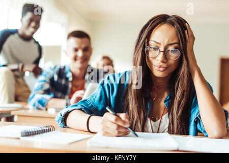 student girl studying in classroom - Stock Photo