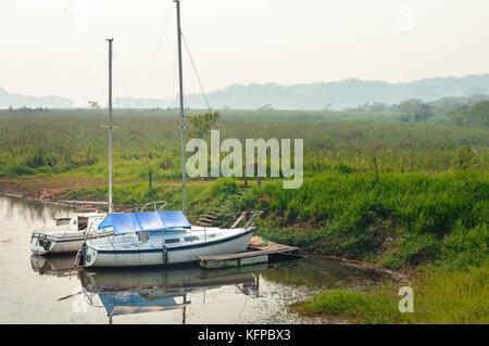Boats and hazy landscapes of Lake de  Yojoa in Western Honduras. Central America - Stock Photo