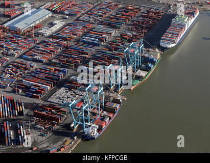 aerial view of 3 ships at Seaforth Docks, a container terminal, on the River Mersey, UK - Stock Photo
