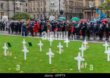 Glasgow, UK. 31st Oct, 2017. In heavy rain, a number of senior military personnel, political dignitaries including - Stock Photo