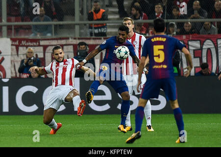 Athens, Greece. 31st Oct, 2017. Panagiotis Tachtsidis (l) of Olympiacos and Paulinho of FC Barcelona vie for the - Stock Photo