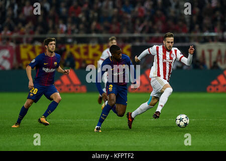 Athens, Greece. 31st Oct, 2017. Konstantinos Fortounis (r) pf Olympiacos and Nelson Semedo of FC Barcelona vie for - Stock Photo