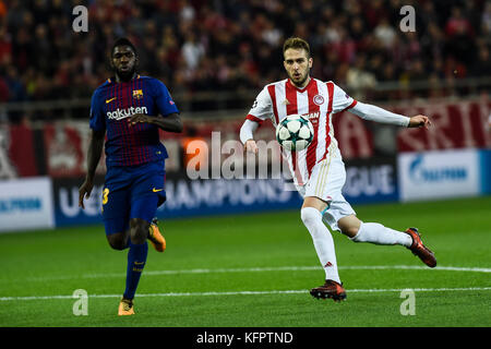 Athens, Greece. 31st Oct, 2017. Konstantinos Fortounis (r) of Olympiacos and Samuel Umtiti of FC Barcelona vie for - Stock Photo