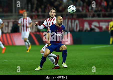 Athens, Greece. 31st Oct, 2017. Konstantinos Fortounis (r) of Olympiacos and Javier Mascherano of FC Barcelona vie - Stock Photo