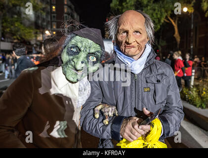 New York, USA. 31st Oct, 2017. Revelers wear costumes as they march through New York's 6th Avenue during the Greenwich - Stock Photo