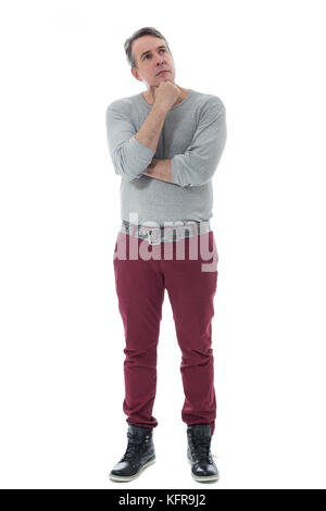 Beautiful man and with gray hair is pondering about a subject. She has her arms crossed and her hand resting on - Stock Photo