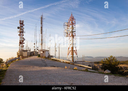 Antennas, devices, transmitters on the steel construction towers. The radio station masts on the mount Pantocrator, - Stock Photo