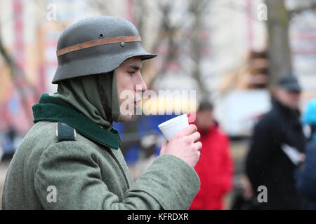Belarus city of Gomel. Reconstruction of the battle of the Second World War .. 21.11.2016 year. Unknown girl in - Stock Photo