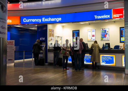 Bureau de Change office operated by Travelex; Terminal 3 / three at London Heathrow airport. UK. (76) - Stock Photo