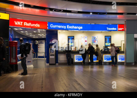 VAT refund desk, and Bureau de Change office operated by Travelex; Terminal 3 / three at London Heathrow airport. - Stock Photo