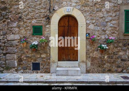 Doorway of traditional stone finca house in valldemossa majorca - Stock Photo