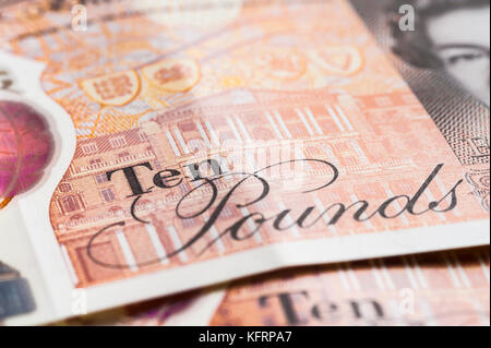 LONDON, ENGLAND – OCTOBER, 24: Closeup of the new British ten-pound note, featuring a portrait of Jane Austen. Stock Photo