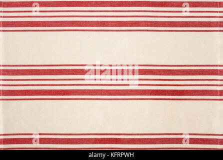Traditional red and white striped cotton fabric kitchen bistro style tea towel tablecloth. Simple, classic, rustic - Stock Photo