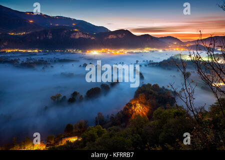 Valley of the Adda river during a foggy morning, Airuno, Italy - Stock Photo