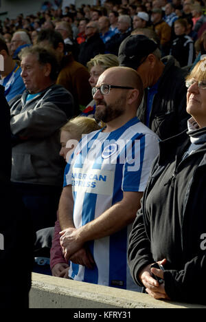 Fans during the minute silence at the Premier League match between Brighton and Hove Albion and Southampton at the - Stock Photo
