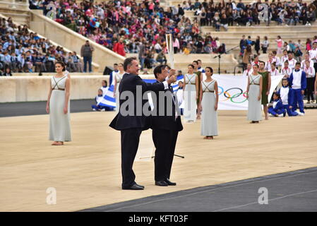 Athens, Greece. 31st Oct, 2017. President of the Hellenic Olympic Committee Spyros Capralos (left) is handover the - Stock Photo