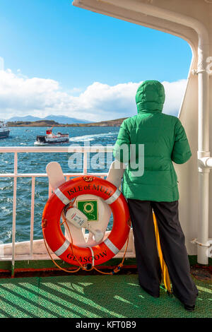 Female tourist aboard the Caledonian MacBrayne ferry boat to the Isle of Mull from Oban, Argyll and Bute, Inner - Stock Photo