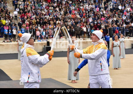 Athens, Greece. 31st Oct, 2017. Last Torchbearer Ioannis Proios (right) is given the Olympic Flame by Kim Ki-hoon - Stock Photo