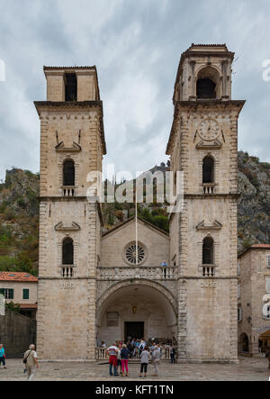 KOTOR, MONTENEGRO - 27 SEPTEMBER, 2017: Tourists gathered outside the Cathedral of St. Tryphon in Kotor, Montenegro. - Stock Photo