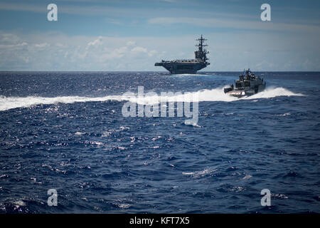 Sailors assigned to Coastal Riverine Squadron (CRS) 2, aboard a MK VI patrol boat, provide high value asset protection - Stock Photo