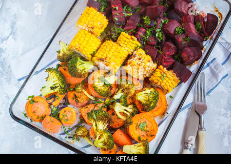 Baked vegetables in a glass dish. Vegan Healthy Food Concept.