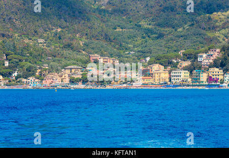 Summer Monterosso view from excursion ship. One of five famous villages of Cinque Terre National Park in Liguria, - Stock Photo