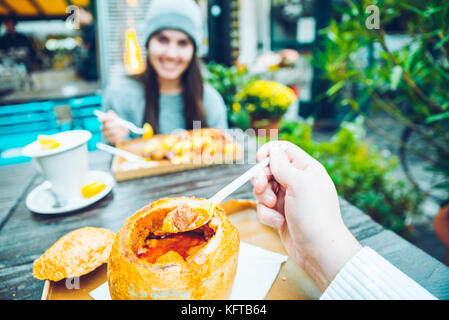 couple eating in cafe outside - Stock Photo