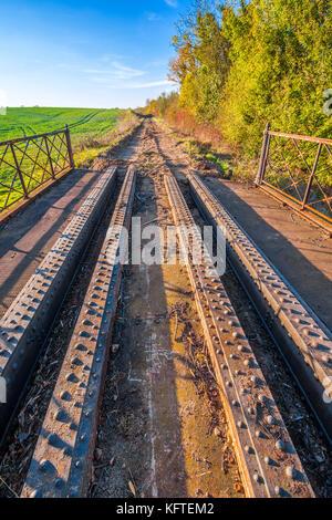 Steel girder bridge remaining on disused / removed railway line - France. - Stock Photo