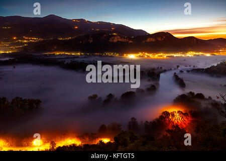 View of the Adda river during a foggy morning, Airuno, Italy - Stock Photo