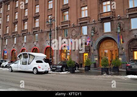 SAINT PETERSBURG, RUSSIA - 12 JANUARY 2017: Wedding limo - coach near the hotel Astoria - Stock Photo