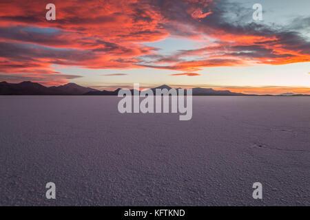 Nice sunset view of Salar Uyuni in Bolivia - Stock Photo