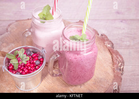 Assorted fruit or berry shakes on white table. Smoothie concept - Stock Photo