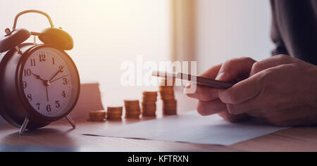 Savings, finances, economy and home budget calculations. Close up of man doing home finances. - Stock Photo