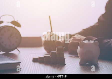 Home budget calculation, man working financial figures. Salary, expenses, taxes and expenditure. Retro toned image - Stock Photo