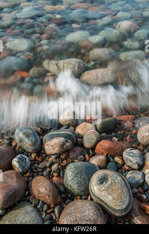 Cobblestones along shore of Gargantua bay, Lake Superior, Lake   Superior Provincial Park, Ontario, Canada by Bruce - Stock Photo