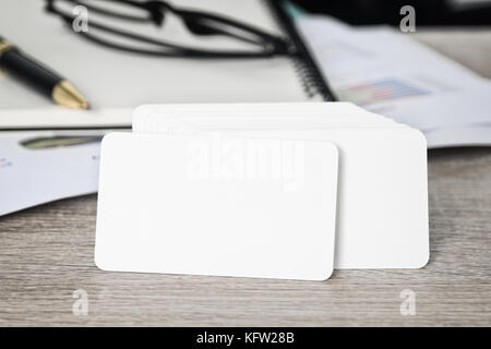 Blank corporate identity business card package on worker table with clipping path on business card for easy design - Stock Photo