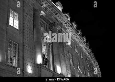 Close up of buildings on Regent Street  London UK. Photographed from street level at night. - Stock Photo