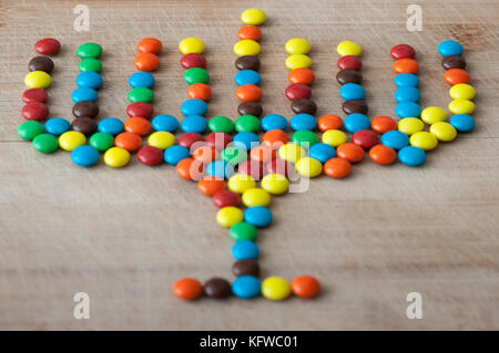 Hanukkah  menorah made out of colorful candy - Stock Photo
