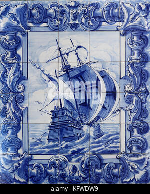 Typical tile artwork in Sintra, Portugal, depicting a Portuguese galleon of the 16th century - Stock Photo