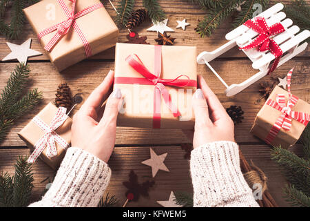 Preparing a Christmas gift for family. - Stock Photo