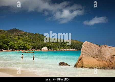 The Seychelles, Praslin, Anse Lazio, beach, tourists bathing in sea - Stock Photo