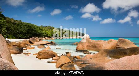 The Seychelles, Praslin, Anse Lazio, beach, granite rocks sculpted by sea, panoramic - Stock Photo