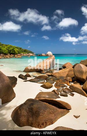 The Seychelles, Praslin, Anse Lazio, beach, red coloured granite rocks sculpted by sea - Stock Photo