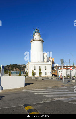 Lighthouse in the port of Malaga, Andalusia, Southern Spain - Stock Photo