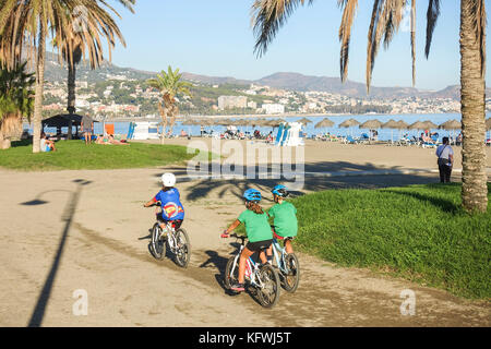 Young kids, sports, cycling on beach, Malaga, Andalusia, Spain. - Stock Photo