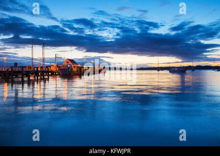 The jetty at Russell, Bay of Islands, New Zealand, at sunset. - Stock Photo