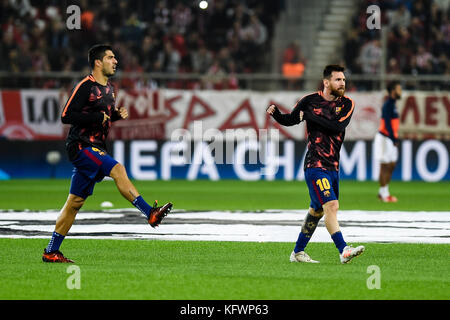 Athens, Greece. 31st Oct, 2017. Luis Suarez (L) and Lionel Messi of Barcelona warm up before the Champions League - Stock Photo
