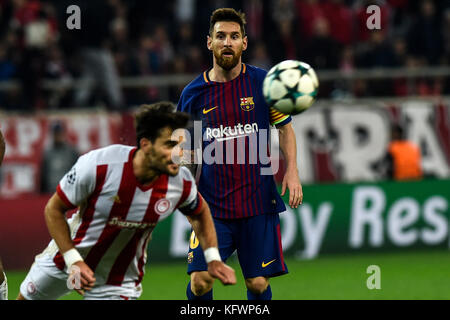 Athens, Greece. 31st Oct, 2017. Konstantinos Fortounis of Olympiacos and Samuel Umtiti of FC Barcelona vie for the - Stock Photo