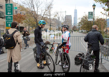 New York, USA. 01st Nov, 2017. Cyclists have a conversation after a terrorist act next to a barrier near the crime - Stock Photo